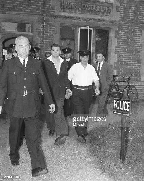 Frank Mitchell the Mad Axeman who escaped from Broadmoor Prison is led away from Hartley Wintney police station after being recaptured on a London...