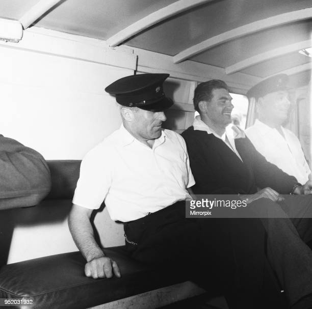 Frank Mitchell the Mad Axeman who escaped from Broadmoor Prison seen inside the police van in the custody of Broadmoor attendants after being...