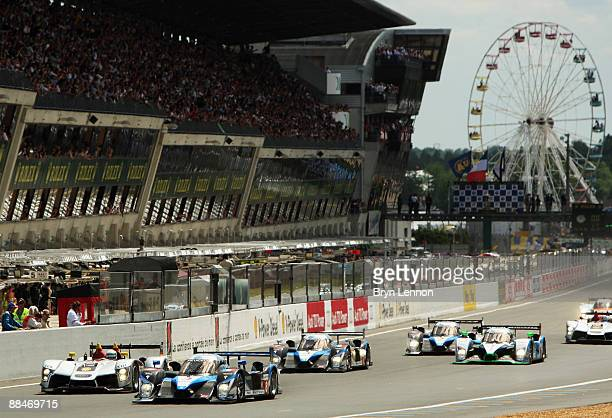 Frank Montagny of Team Peugeot Total and Allan McNish of Audi Sport Team Joest head the field at the start of the 77th running of the Le Mans 24 Hour...