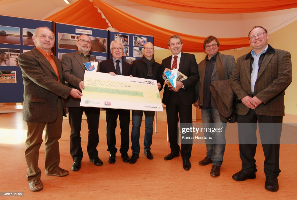 DFB And League Council Handover Donations To German Flood Aid