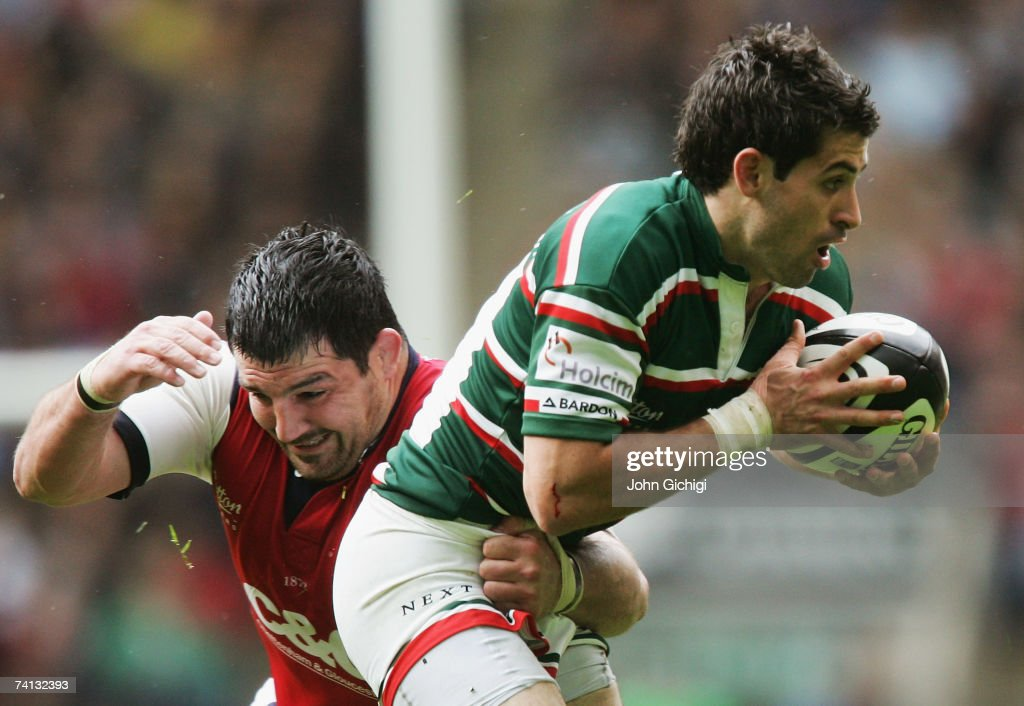 Frank Murphy of Leicester is tackled by Olivier Azam of Gloucester during the Guinness Premiership final between Gloucester and Leicester Tigers at Twickenham on May 12, 2007 in London, England.