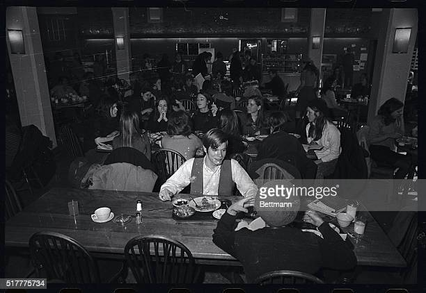 Frank N Cobb a student from Wesleyan is outnumbered by the girls as he ate lunch in the cafeteria of Sarah Lawrence College February 5th Cobb is one...