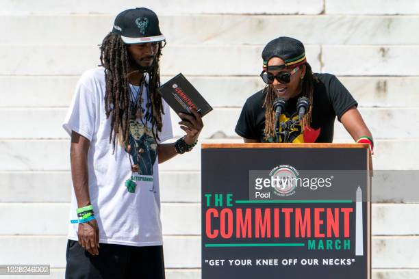 """Frank """"Nitty"""" Sensabaugh, left, listens as Sandy Solo, speaks, as the activists from Milwaukee speak during the March on Washington at the Lincoln..."""