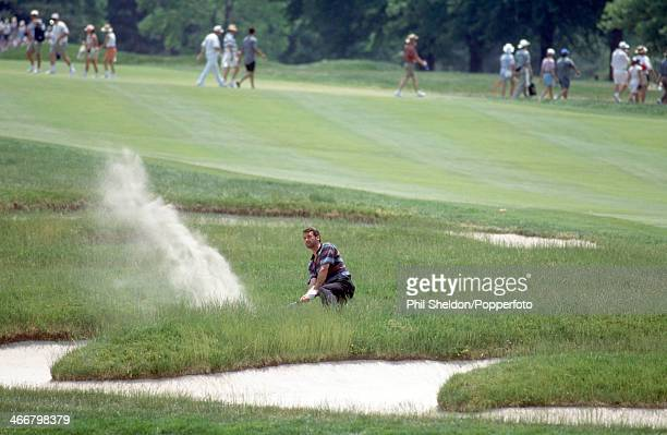 Frank Nobilo of New Zealand playing out of a bunker during the US Open Golf Championship held at the Oakmont Country Club in Pennsylvania circa June...