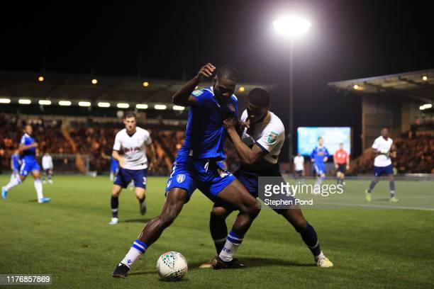 Frank Nouble of Colchester United is challenged by Japhet Tanganga of Tottenham Hotspur during the Carabao Cup Third Round match between Colchester...