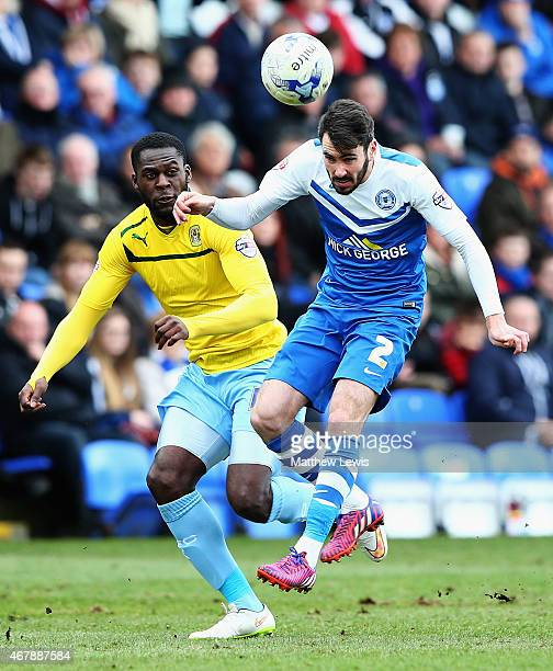 Frank Nouble of Coventry City and Michael Smith of Peterborough United challenge for the ball during the Sky Bet League One match between...