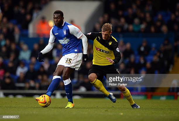Frank Nouble of Ipswich Town is challenged by Joel Ekstrand of Watford during the Sky Bet Championship match between Ipswich Town and Watford at...