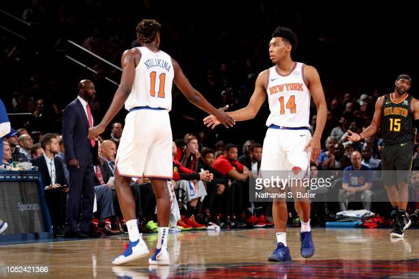 Frank Ntilikina and Allonzo Trier of the New York Knicks exchange high fives against the Atlanta Hawks during the game on October 17 2018 at Madison...