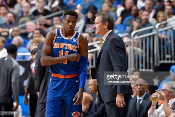 Frank Ntilikina and Coach Jeff Hornacek of the New York Knicks speak during the game against the Orlando Magic on November 8 2017 at Amway Center in...