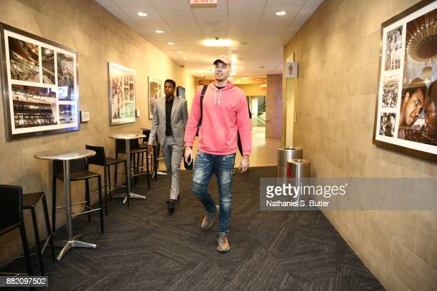 Frank Ntilikina and Willy Hernangomez of the New York Knicks arrive to the arena prior to the game against the Miami Heat on November 29 2017 at...