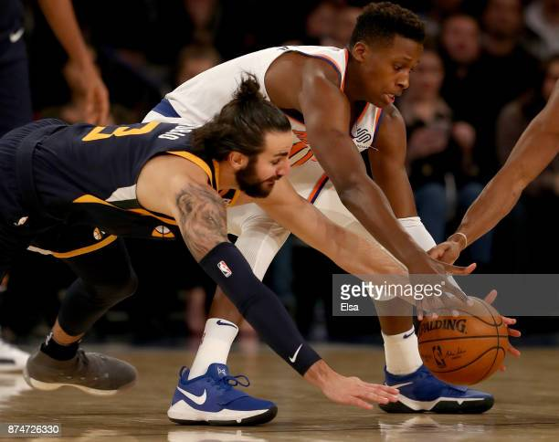 Frank Ntilikina of the New York Knicks and Ricky Rubio of the Utah Jazz chase after the loose ball in the second half at Madison Square Garden on...