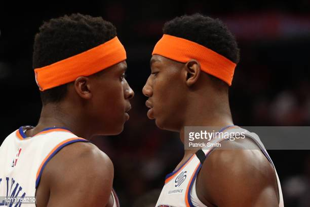 Frank Ntilikina of the New York Knicks and RJ Barrett of the New York Knicks look on against the Washington Wizards during the first half at Capital...