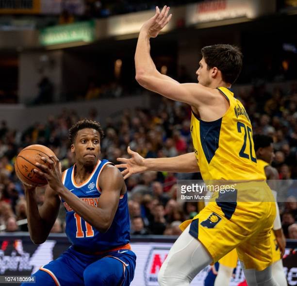 Frank Ntilikina of the New York Knicks attempts to keep the ball from Doug McDermott of the Indiana Pacers during the first half of the game at...