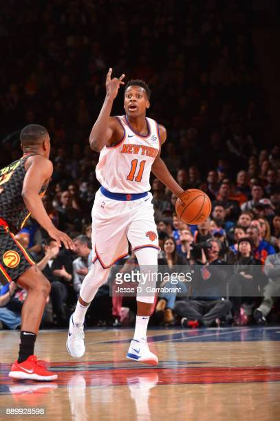 Frank Ntilikina of the New York Knicks calls a play against the Atlanta Hawks at Madison Square Garden on December 10 2017 in New York New York NOTE...