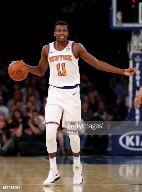 Frank Ntilikina of the New York Knicks calls out the play in the first half against the Brooklyn Nets at Madison Square Garden on October 27 2017 in...