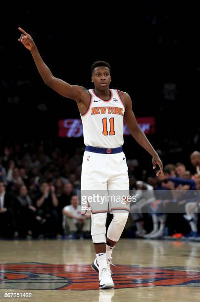 Frank Ntilikina of the New York Knicks celebrates his shot against the Brooklyn Nets at Madison Square Garden on October 27 2017 in New York City...