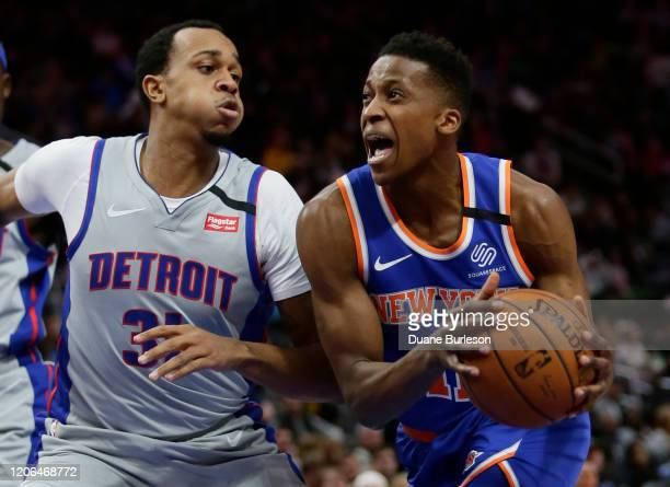 Frank Ntilikina of the New York Knicks drives against John Henson of the Detroit Pistons during the first half at Little Caesars Arena on February 8...