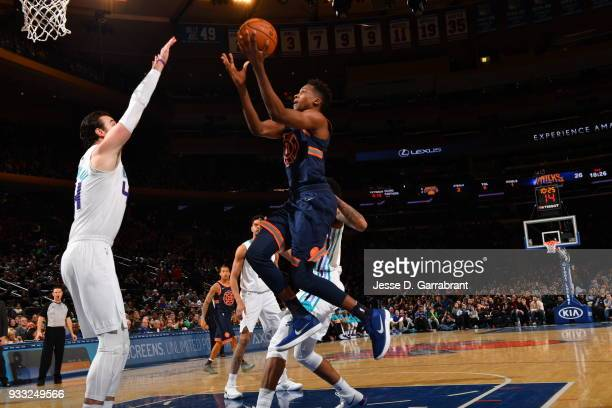 Frank Ntilikina of the New York Knicks goes up for the layup against the Charlotte Hornets at Madison Square Garden on March 17 2018 in New YorkNew...