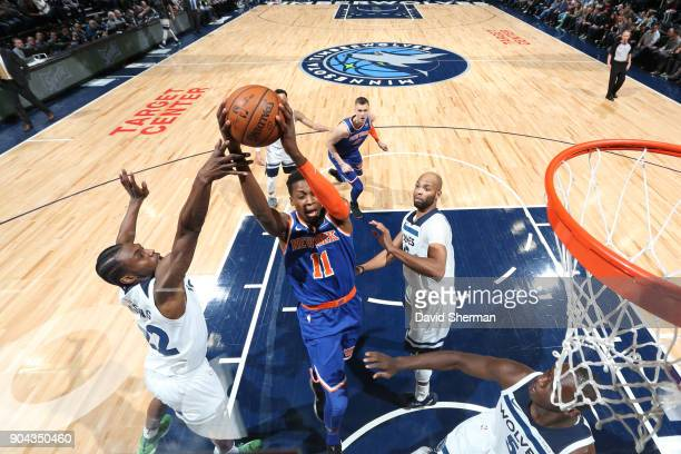 Frank Ntilikina of the New York Knicks grabs the rebound against the Minnesota Timberwolves on January 12 2018 at Target Center in Minneapolis...