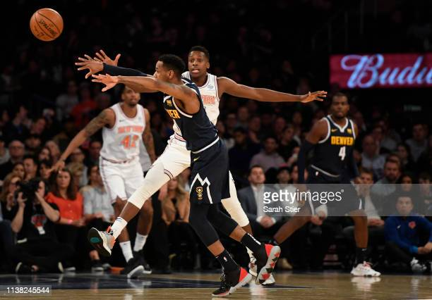 Frank Ntilikina of the New York Knicks guards Monte Morris of the Denver Nuggets during the second half of the game at Madison Square Garden on March...