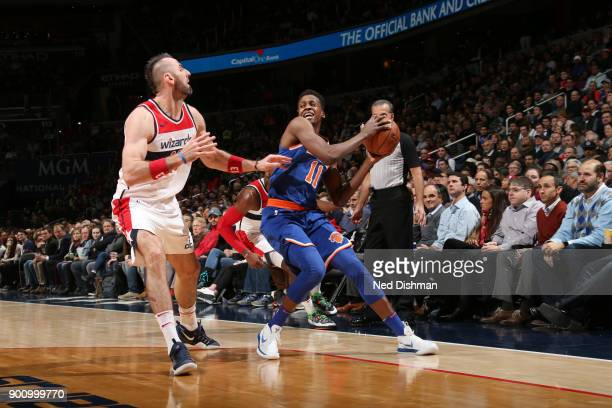 Frank Ntilikina of the New York Knicks handles the ball against Marcin Gortat of the Washington Wizards on January 3 2018 at Capital One Arena in...