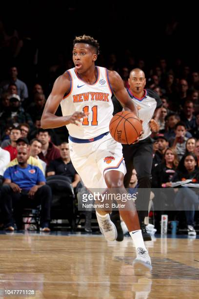 Frank Ntilikina of the New York Knicks handles the ball against the Washington Wizards during a preseason game on October 8 2018 at Madison Square...