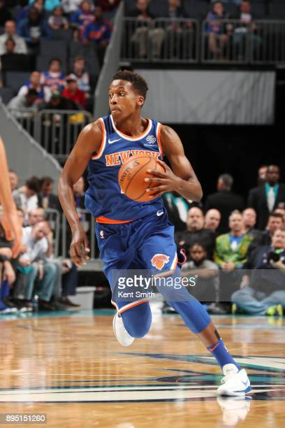 Frank Ntilikina of the New York Knicks handles the ball against the Charlotte Hornets on December 18 2017 at Spectrum Center in Charlotte North...