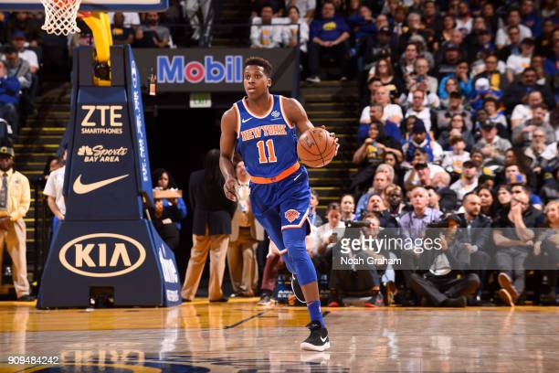 Frank Ntilikina of the New York Knicks handles the ball against the Golden State Warriors on January 23 2018 at ORACLE Arena in Oakland California...