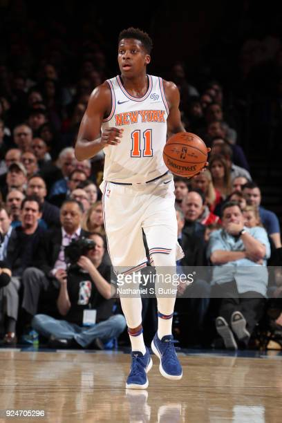 Frank Ntilikina of the New York Knicks handles the ball against the Golden State Warriors on February 26 2018 at Madison Square Garden in New York...