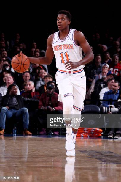 Frank Ntilikina of the New York Knicks handles the ball during the game against the Los Angeles Lakers on December 12 2017 at Madison Square Garden...