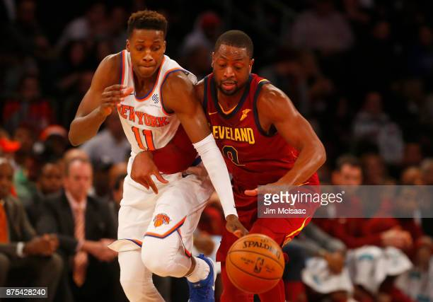 Frank Ntilikina of the New York Knicks in action against Dwyane Wade of the Cleveland Cavaliers at Madison Square Garden on November 13 2017 in New...