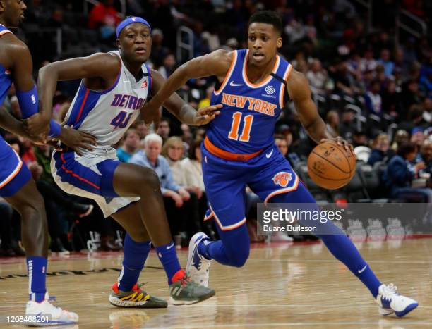 Frank Ntilikina of the New York Knicks is guarded by Sekou Doumbouya of the Detroit Pistons during the first half at Little Caesars Arena on February...