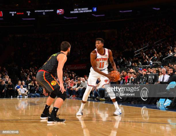 Frank Ntilikina of the New York Knicks looks to pass the ball against the Atlanta Hawks at Madison Square Garden on December 10 2017 in New York New...