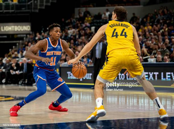 Frank Ntilikina of the New York Knicks looks to push past Bojan Bogdanovic of the Indiana Pacers during the first half of the game at Bankers Life...