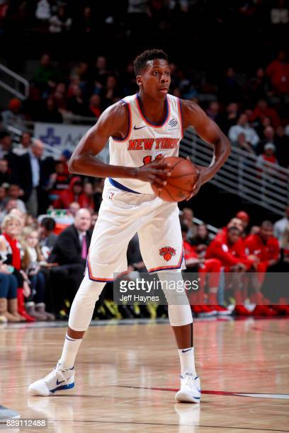 Frank Ntilikina of the New York Knicks passes the ball against the Chicago Bulls on December 9 2017 at the United Center in Chicago Illinois NOTE TO...