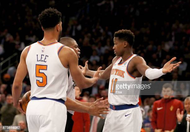 Frank Ntilikina of the New York Knicks reacts after he is called for a foul in the first half against the Cleveland Cavaliers as teammate Courtney...