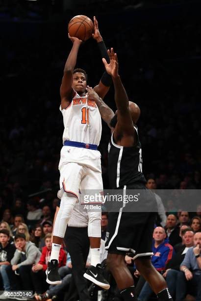Frank Ntilikina of the New York Knicks shoots against Quincy Acy of the Brooklyn Nets during their game at the Barclays Center on January 15 2018 in...