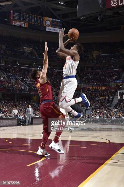 Frank Ntilikina of the New York Knicks shoots the ball against London Perrantes of the Cleveland Cavaliers on April 11 2018 at Quicken Loans Arena in...
