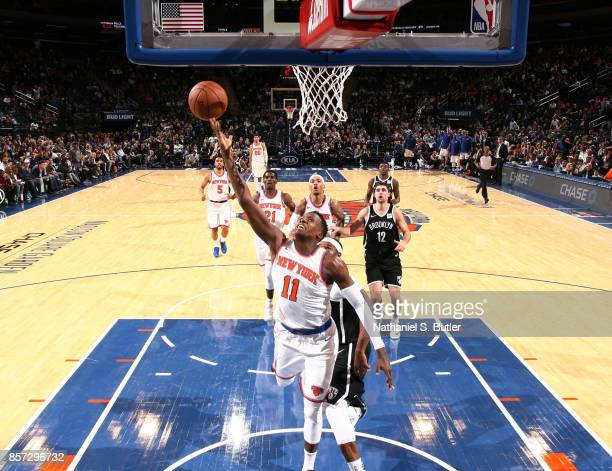 Frank Ntilikina of the New York Knicks shoots the ball against the Brooklyn Nets during the preseason game on October 3 2017 at Madison Square Garden...