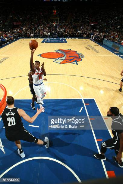 Frank Ntilikina of the New York Knicks shoots the ball against the Brooklyn Nets on October 27 2017 at Madison Square Garden in New York City New...