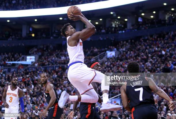 Frank Ntilikina of the New York Knicks shoots the ball as Kyle Lowry of the Toronto Raptors defends during the first half of an NBA game at...