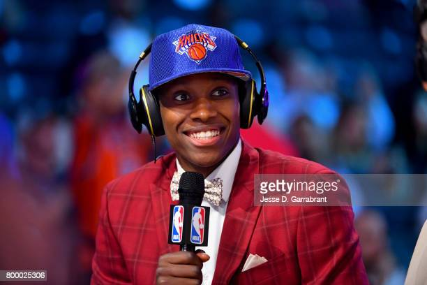 Frank Ntilikina of the New York Knicks smiles while talking to the media after being the eighth overall selected at the 2017 NBA Draft on June 22...