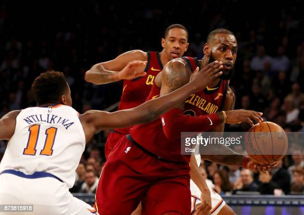 Frank Ntilikina of the New York Knicks tries to stop LeBron James of the Cleveland Cavaliers in the first half at Madison Square Garden on November...