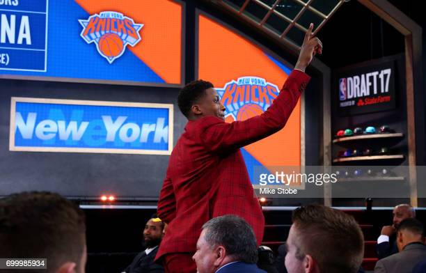 Frank Ntilikina walks to the stage after being drafted eighth overall by the New York Knicks during the first round of the 2017 NBA Draft at Barclays...