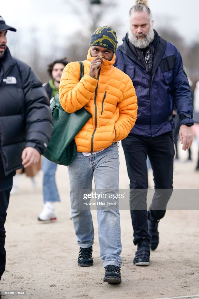 Frank Ocean Tour 2020 Frank Ocean wears an orange puffer jacket, a beanie hat from