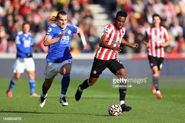 Frank Onyeka of Brentford runs with the ball whilst under pressure from Caglar Soyuncu of Leicester City during the Premier League match between...