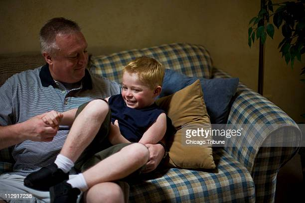 Frank Osowski left plays with his son Ben at their home in Mokena Illinois on June 12 2008 Ben suffers from epidermolytic hyperkeratosis or EHK a...