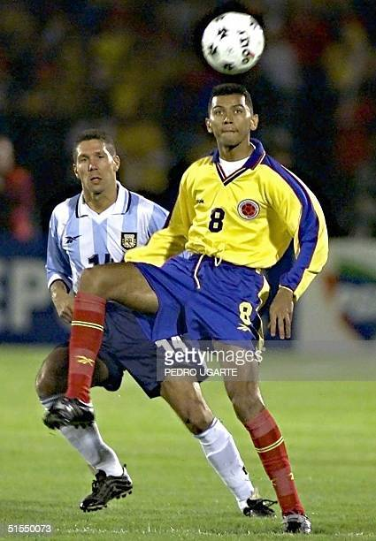 Frank Oviedo of Colombia kicks the ball in front of Diego Simeone of Argentina during their 29 June 2000 elimination match in Bogota Frank Oviedo de...