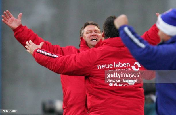 Frank Pagelsdorf , coach of Rostock, celebrates the second goal with other team members during the Second Bundesliga match between Hansa Rostock and...