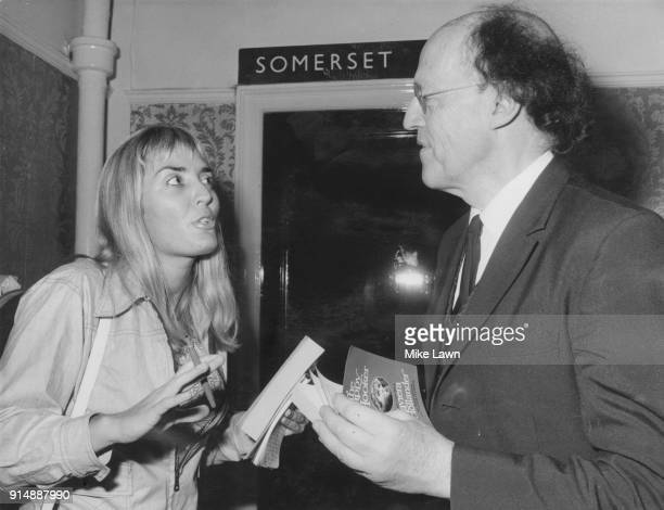 Frank Pakenham 7th Earl of Longford gives a copy of his Pornography Report to former escort Xaviera Hollander at the Waldorf Hotel in London and...